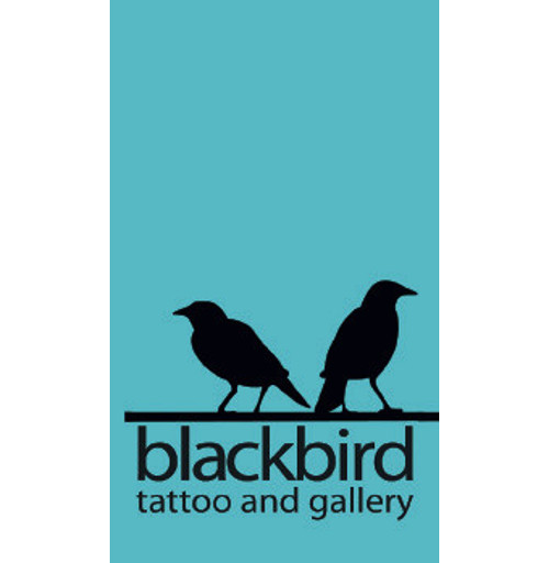 Front of business card for Blackbird Tattoo and Gallery.