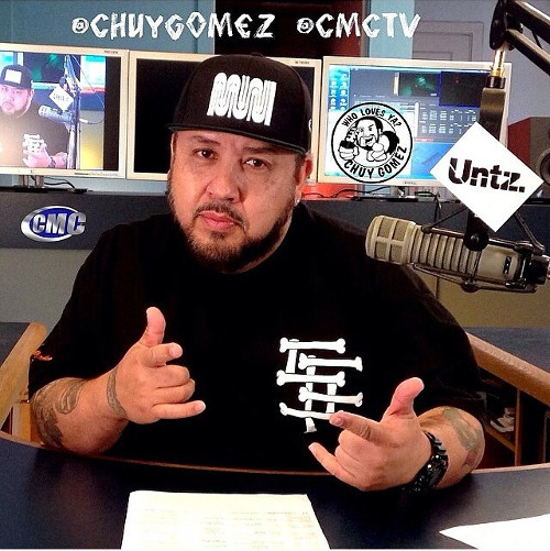 Chuy Gomez and an Untz slap on his mic on his radio show at CMCTV.
