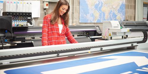 woman at printing banner