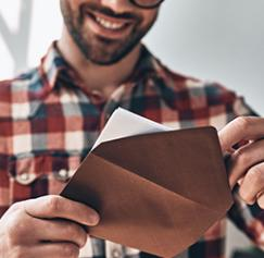 Man opening a printed invitation